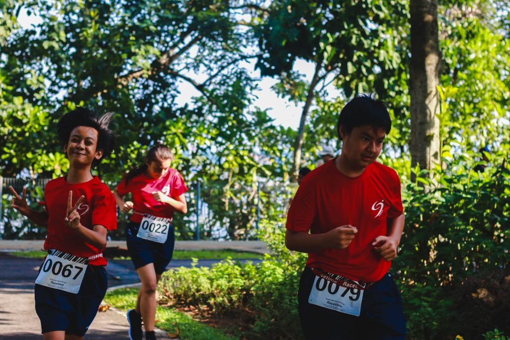 Students in physical running (in red shirt).jpg